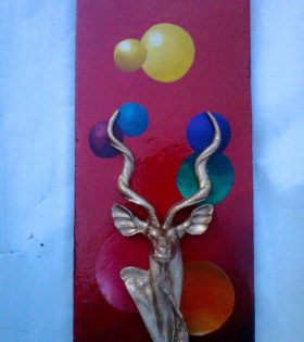 Animal sculpture on a painted background wall hanging