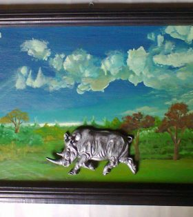 Rhino sculpture on painted background wall hanging